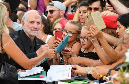 Brian De Palma (2-L) signs autographs for fans as he arrives for the premiere of 'Marriage Story' during the 76th annual Venice International Film Festival, in Venice, Italy, 29 August 2019. The movie is presented in the official competition 'Venezia 76' at the festival running from 28 August to 07 September.