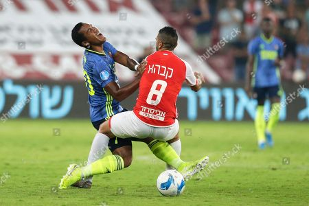Renato Tapia (L) of Feyenoord in action against Marwan Kabha (R) of Hapoel Beer Sheva during the UEFA Europa League playoff, second leg soccer match between Hapoel Beer Sheva and Feyenoord Rotterdam in Beer Sheva, Israel, 29 August 2019.