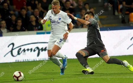 Herdi Prenga (R) of Riga and Viktor Fischer of Copenhagen in action during the UEFA Europa league play-off second leg soccer match between Riga FC and FC Copenhagen in Riga, Latvia, 29 August 2019.
