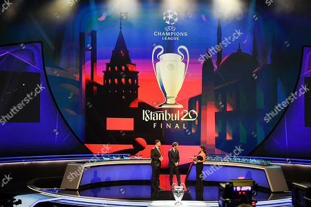 Hosts Pedro Pinto (L) and Reshmin Chowdhury (R) speak with the 2020 Istanbul final ambassador Hamit Altintop during the UEFA Champions League 2019-20 Group Stage draw ceremony in Monaco, 29 August 2019.