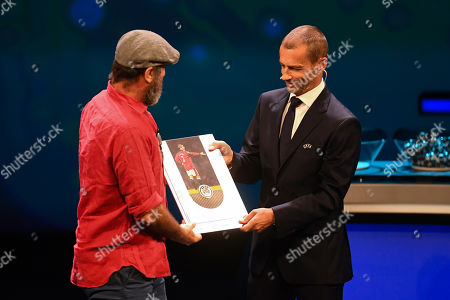 Former Manchester United forward Eric Cantona (C) receives the UEFA President's Award from UEFA president Aleksander Ceferin during the UEFA Champions League 2019-20 Group Stage draw in Monaco, 29 August 2019