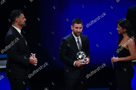 Lionel Messi of Barcelona receives the Forward of the season 2018/19 award from hosts Pedro Pinto (L) and Reshmin Chowdhury (R) during the UEFA Champions League 2019-20 Group Stage draw ceremony in Monaco, 29 August 2019.