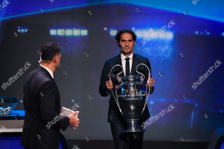 2020 Istanbul final ambassador Hamit Altintop brings the trophy on stage during the UEFA Champions League 2019-20 Group Stage draw ceremony in Monaco, 29 August 2019.