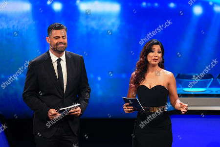 Hosts Pedro Pinto (L) and Reshmin Chowdhury (R) during the UEFA Champions League 2019-20 Group Stage draw ceremony in Monaco, 29 August 2019.