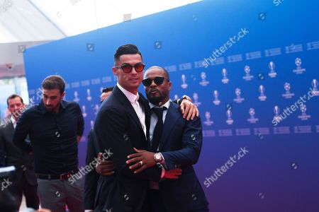 Cristiano Ronaldo (L) of Juventus and former French international Patrice Evra arrive for the UEFA Champions League 2019-20 Group Stage draw ceremony in Monaco, 29 August 2019.