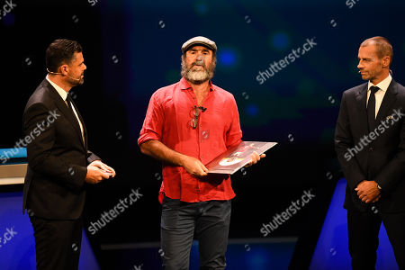 Former Manchester United forward Eric Cantona (C) receives the UEFA President's Award from UEFA president Aleksander Ceferin during the UEFA Champions League 2019-20 Group Stage draw in Monaco, 29 August 2019.