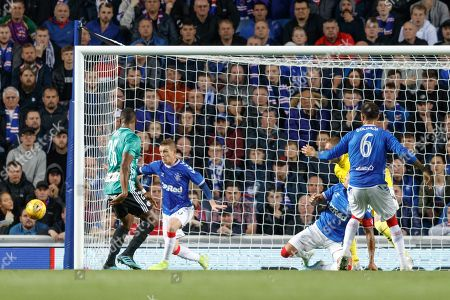 Stock Picture of Cafu of Legia Warsaw heads wide of the Rangers goal.