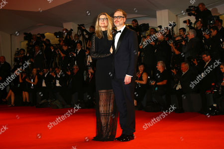 James Gray, right, and his wife Alexandra Dickson pose for photographers upon arrival at the premiere of the film 'Ad Astra' at the 76th edition of the Venice Film Festival, Venice, Italy