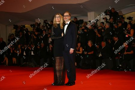 Stock Image of James Gray, Alexandra Dickson Gray. James Gray and Alexandra Dickson Gray pose for photographers upon arrival at the premiere of the film 'Ad Astra' at the 76th edition of the Venice Film Festival, Venice, Italy