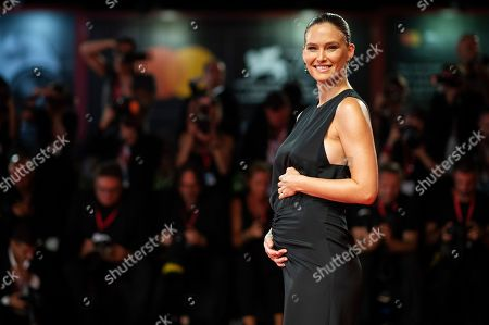 Bar Refaeli holds her stomach as she poses for photographers upon arrival at the premiere of the film 'Ad Astra' at the 76th edition of the Venice Film Festival, Venice, Italy