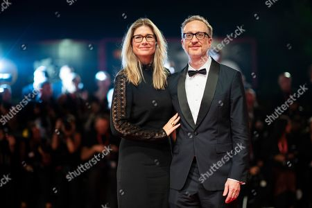 James Gray, Alexandra Dickson. Director James Gray, right, and his wife Alexandra Dickson pose for photographers upon arrival at the premiere of the film 'Ad Astra' at the 76th edition of the Venice Film Festival, Venice, Italy