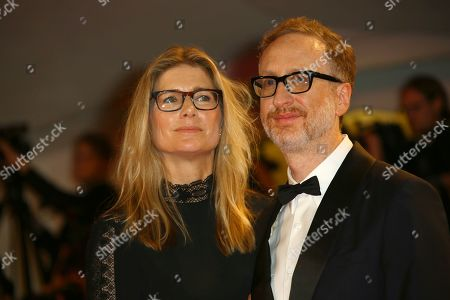 Stock Photo of James Gray, right, and his wife Alexandra Dickson Gray pose for photographers upon arrival at the premiere of the film 'Ad Astra' at the 76th edition of the Venice Film Festival, Venice, Italy