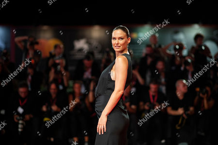 Bar Refaeli poses for photographers upon arrival at the premiere of the film 'Ad Astra' at the 76th edition of the Venice Film Festival, Venice, Italy