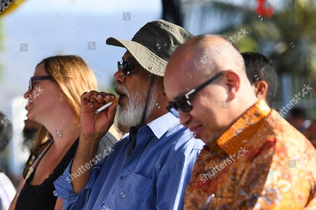 Former Prime Minister of East Timor Xanana Gusmao smokes as he attends the inauguration of a bridge named after former Indonesian President Bacharuddin Jusuf Habibie in Dili, East Timor, 29 August 2019. East Timor is celebrating the 20th anniversary of its independence from Indonesia on 30 August 2019.