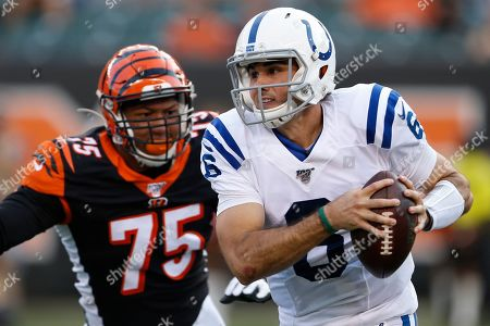 Chad Kelly, Jordan Willis. Indianapolis Colts quarterback Chad Kelly runs the ball under pressure from Cincinnati Bengals defensive end Jordan Willis (75) during the first half of an NFL preseason football game, in Cincinnati