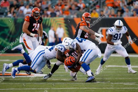 Ryan Glasgow, Noah Dawkins, Clayton Fejedelem. Cincinnati Bengals defensive tackle Ryan Glasgow (98) is tackled by Indianapolis Colts outside linebacker Zaire Franklin (44) and defensive back Rolan Milligan (42) during the first half of an NFL preseason football game, in Cincinnati