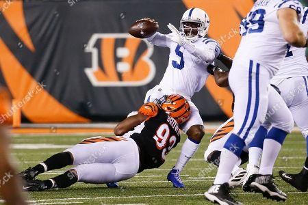 Phillip Walker, Andrew Brown. Indianapolis Colts quarterback Phillip Walker (5) is sacked by Cincinnati Bengals defensive tackle Andrew Brown (93) during the second half of an NFL preseason football game, in Cincinnati