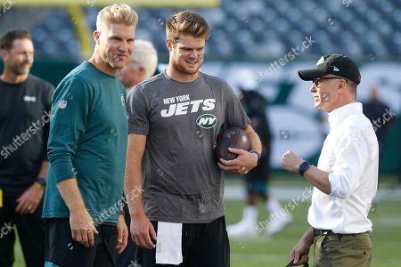 Philadelphia Eagles quarterback Carson Wentz, left, New York Jets quarterback Sam Darnold, center, and Jets owner Woody Johnson talk before a preseason NFL football game, in East Rutherford, N.J