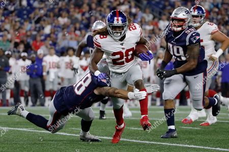New England Patriots linebacker Calvin Munson (48) tackles New York Giants running back Paul Perkins (28) in the first half of an NFL preseason football game, in Foxborough, Mass