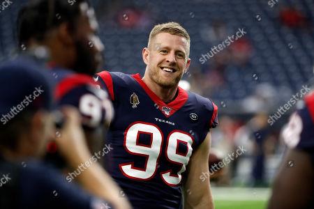 Houston Texans defensive end J. J. Watt (99) smiles before a preseason NFL football game against the Los Angeles Rams, in Houston