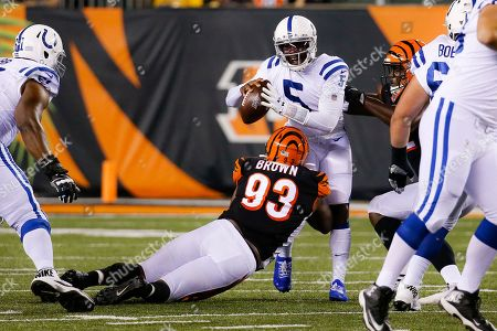 Indianapolis Colts quarterback Phillip Walker (5) is sacked by Cincinnati Bengals defensive tackle Andrew Brown (93) during the second half of an NFL preseason football game, in Cincinnati
