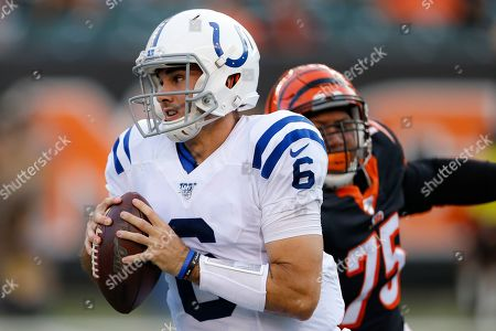 Indianapolis Colts quarterback Chad Kelly (6) looks to pass under pressure from Cincinnati Bengals defensive end Jordan Willis (75) during the first half of an NFL preseason football game, in Cincinnati