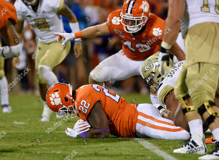 Xavier Kelly, Chad Smith. Clemson's Xavier Kelly (22) recovers a fumble while Chad Smith (43) blocks during the first half of an NCAA college football game against Georgia Tech, in Clemson, S.C. Clemson won 52-14