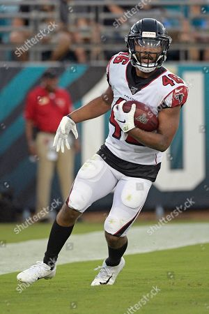 Atlanta Falcons running back Tony Brooks-James runs thought the end zone after a touchdown against the Jacksonville Jaguars during the first half of an NFL preseason football game, in Jacksonville, Fla