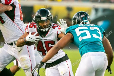 Atlanta Falcons running back Tony Brooks-James (46) stiff arms Jacksonville Jaguars inside linebacker Ramik Wilson (53) during the first half of an NFL preseason football game, in Jacksonville, Fla
