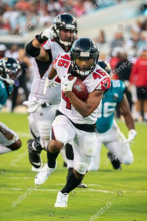 Atlanta Falcons running back Tony Brooks-James (46) runs into the end zone for a touchdown during the first half of an NFL preseason football game against the Jacksonville Jaguars, in Jacksonville, Fla