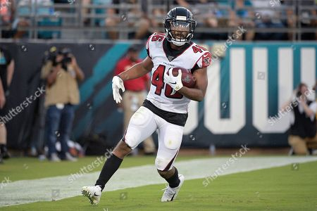 Atlanta Falcons running back Tony Brooks-James (46) celebrates after rushing for a touchdown during the first half of a preseason NFL football game against the Jacksonville Jaguars, in Jacksonville, Fla