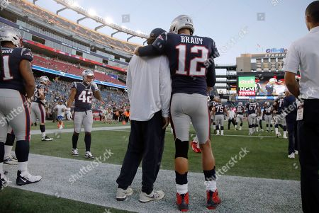 New England Patriots quarterback Tom Brady (12) stands with center David Andrews as the team warms up before an NFL preseason football game against the New York Giants, in Foxborough, Mass