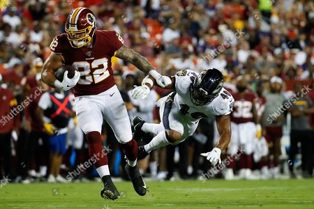 Craig Reynolds, Anthony Levine. Washington Redskins running back Craig Reynolds (22) gets away from Baltimore Ravens defensive back Anthony Levine (41) during the first half of an NFL preseason football game, in Landover, Md
