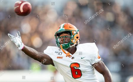 Florida A&M wide receiver Chris Sanders warms up before an NCAA college football game against Central Florida, in Orlando, Fla