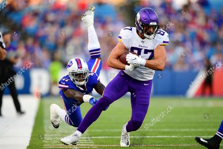 Minnesota Vikings tight end Cole Hikutini (87) eludes a tackle by Buffalo Bills linebacker Maurice Alexander (41) during the first half of an NFL preseason football game in Orchard Park, N.Y