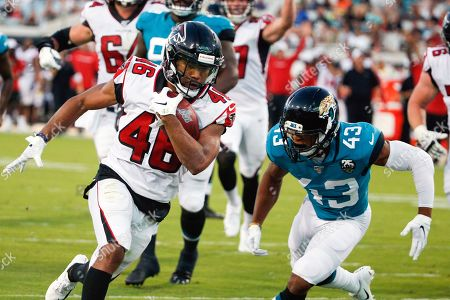 Atlanta Falcons running back Tony Brooks-James, left, runs past Jacksonville Jaguars defensive back Picasso Nelson (43) for a 15-yard touchdown run during the first half of an NFL preseason football game, in Jacksonville, Fla