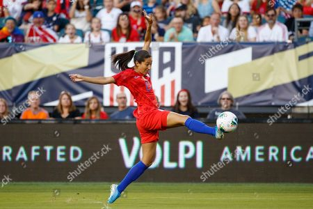 United States' Christen Press lunges for the ball during the first half of the team's international friendly soccer match against Portugal, in Philadelphia