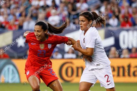 Christen Press, Mónica Mendes. United States' Christen Press, left, and Portugal's Mónica Mendes compete for position during the first half of an international friendly soccer match, in Philadelphia. The United States won 4-0