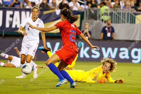 Portugal goalkeeper Patricia Morais (12) looks on as United States forward Christen Press (23) is about to kick the ball for a goal during the Victory Tour match between Portugal and the United States at Lincoln Financial Field in Philadelphia, Pennsylvania