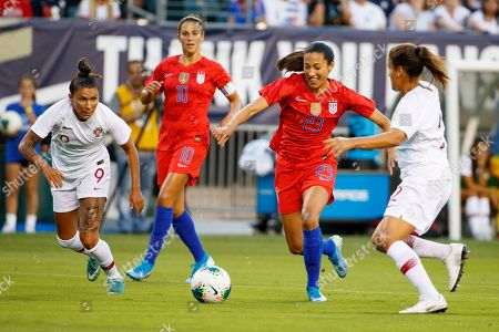 United States forward Christen Press (23) goes after the ball against Portugal defender Ana Borges (9) and defender Monica Mendes (2) during the Victory Tour match between Portugal and the United States at Lincoln Financial Field in Philadelphia, Pennsylvania