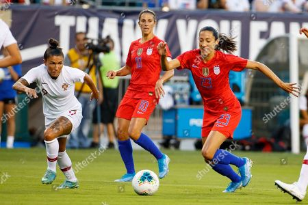 United States forward Christen Press (23) goes after the ball against Portugal defender Ana Borges (9) during the Victory Tour match between Portugal and the United States at Lincoln Financial Field in Philadelphia, Pennsylvania
