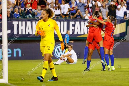 United States forward Christen Press (23) leaps into the arms of forward Jessica McDonald (22) with forward Mallory Pugh (2) near by as they celebrate Press' goal against Portugal goalkeeper Patricia Morais (12) during the Victory Tour match between Portugal and the United States at Lincoln Financial Field in Philadelphia, Pennsylvania