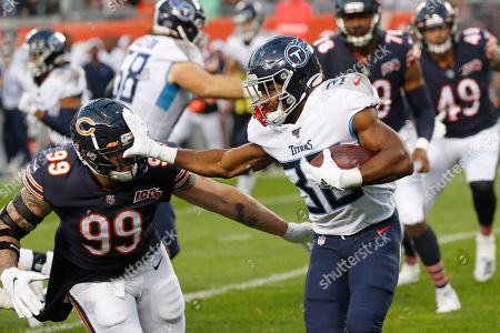 Tennessee Titans running back Jeremy McNichols (30) is chased by Chicago Bears outside linebacker Aaron Lynch (99) during the first half of an NFL preseason football game, in Chicago