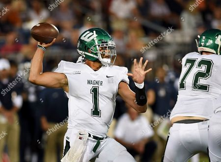 Wagner quarterback Christian Alexander-Stevens (1) sets to pass during the first half of the team's NCAA college football game against Connecticut, in East Hartford, Conn