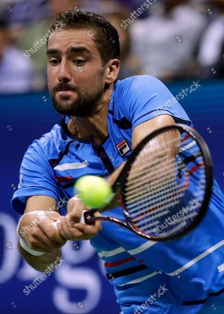 Stock Picture of Marin Cilic, of Croatia, returns a shot to Cedrik-Marcel Stebe, of Germany, during the second round of the U.S. Open tennis tournament, in New York