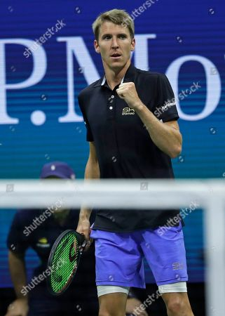 Cedrik-Marcel Stebe, of Germany, reacts against Marin Cilic, of Croatia, during the second round of the U.S. Open tennis tournament, in New York