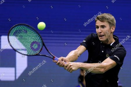 Stock Photo of Cedrik-Marcel Stebe, of Germany, returns a shot to Marin Cilic, of Croatia, during the second round of the U.S. Open tennis tournament, in New York