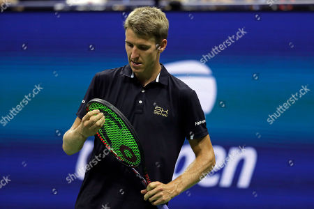Stock Image of Cedrik-Marcel Stebe, of Germany, reacts against Marin Cilic, of Croatia, during the second round of the U.S. Open tennis tournament, in New York