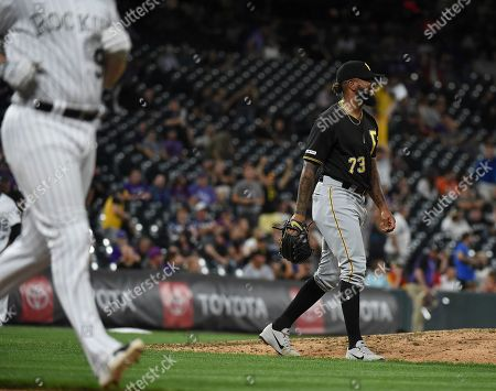 Pittsburgh Pirates relief pitcher Felipe Vazquez (73) smiles as he gets Colorado Rockies' Daniel Murphy (9) to line out for the final out of a baseball game, in Denver