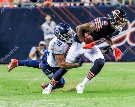 Stock Image of Tennessee Titans defensive back D'Andre Payne (L) tackles Chicago Bears wide receiver Joe Walker (R) during the NFL American Football game between the Tennessee Titans and the Chicago Bears at Soldier Field in Chicago, Illinois, USA, 29 August 2019.